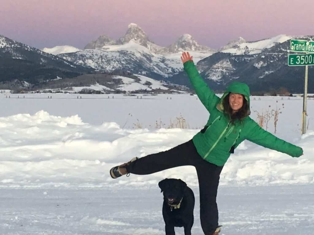 Rochelle poses with her dog in the snow at the Grand Tetons